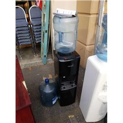 Black Primo top-load water cooler with two jugs