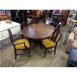 ROUND CARVED BASE DINING TABLE WITH LEAF AND 6 SHIELD BACK DINING CHAIRS