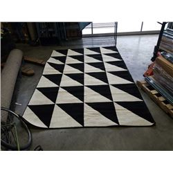 9 FOOT 9 INCH X 6 FOOT 7 INCH AREA CARPET BLACK AND WHITE