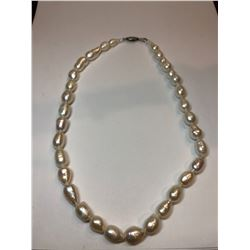 A Single Strand of Cultured Fresh Water Pearls with White Metal Clasp
