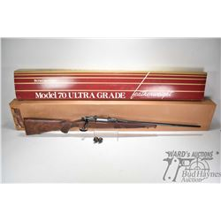 Non-Restricted rifle Winchester model 70 Featherweight Ultra Gr, 270 Win. three shot bolt action, w/
