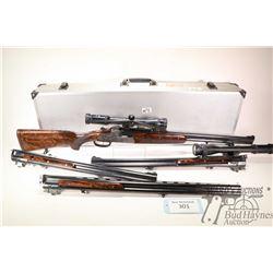 Non-Restricted shotgun/rifle J. Fanzoj model Custom over/under, multiple caliber two shot hinge brea