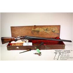 "Non-Restricted shotgun I. Hollis & Sons model SXS, 12Ga two shot hinge break, w/ bbl length 28 3/4"""