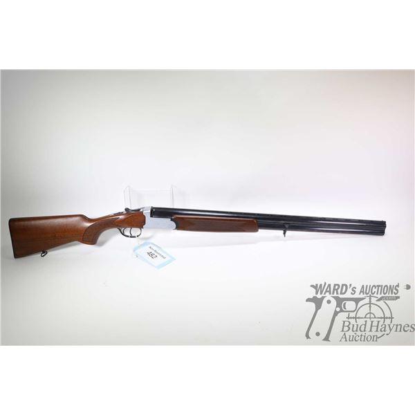 "Non-Restricted shotgun Marocchi model Over Under, 12Ga 2 3/4"" two shot hinge break, w/ bbl length 28"