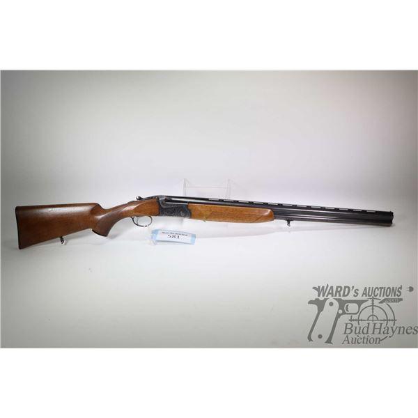 """Non-Restricted shotgun SKB model 500, 12Ga 2 3/4"""" two shot hinge break, w/ bbl length 28"""" [Blued rib"""