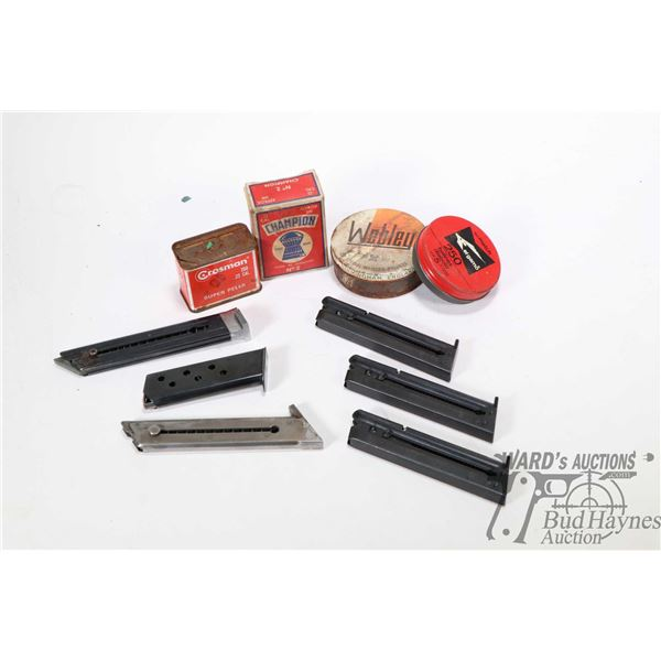 Six assorted pistol magazines and a selection of 22 caliber pellets