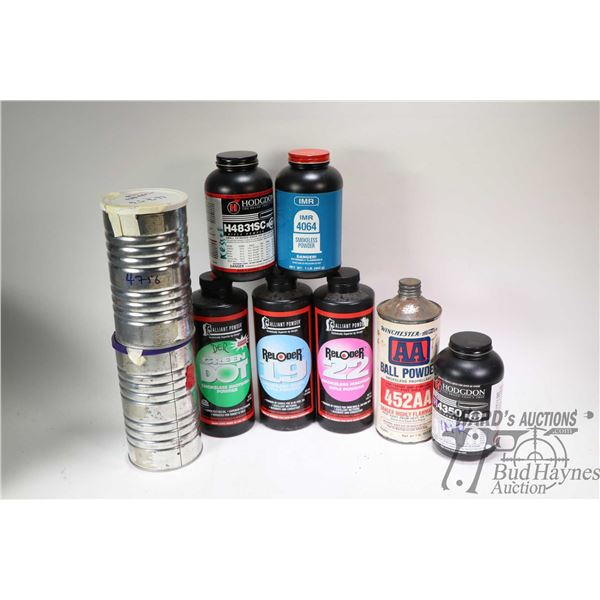Selection of 1 lbs. smokeless gun powder containers, two appear full IMR 406 and Hodgdon H4831SC and