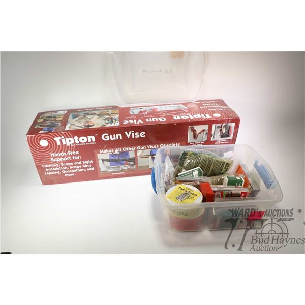 Tipton Gun Vise in original box and selection of cleaning supplies including pull-through snakes, cl
