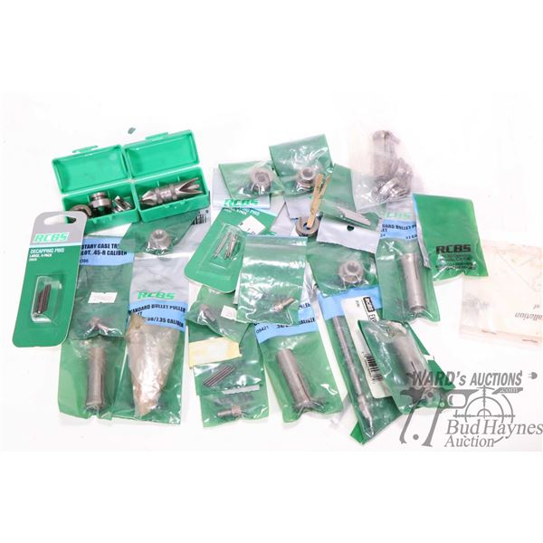 Selection of mostly new in package RCBS loading accessories including shell holders, trimmer pilots,
