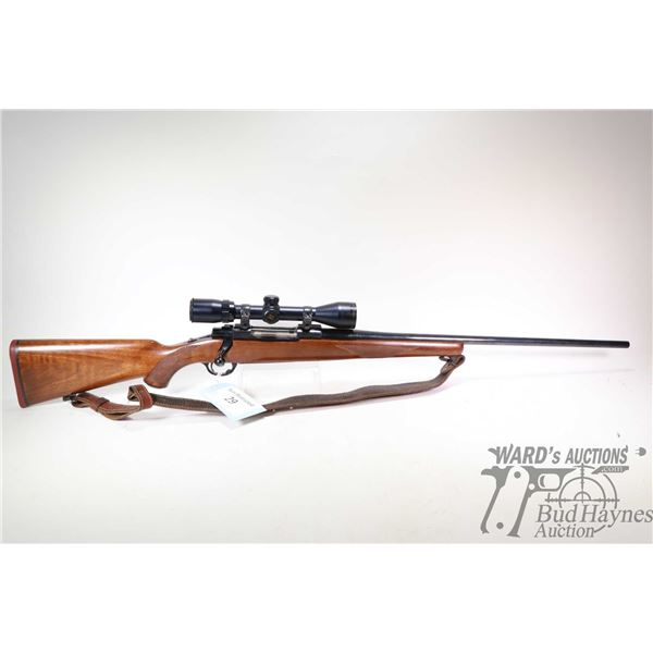 "Non-Restricted rifle Ruger model M77, 7mm Rem. Mag bolt action, w/ bbl length 24"" [Blued barrel and"