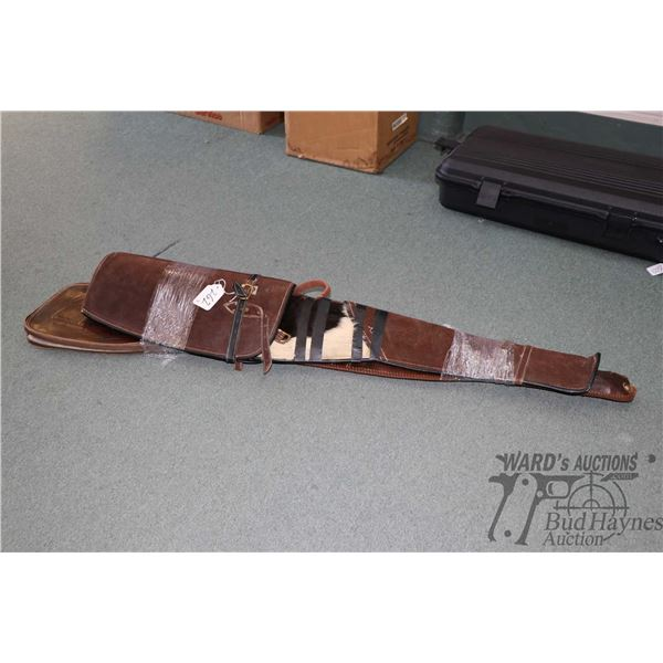Two leather rifle cases including one tooled and one with hide covering. Note: Not available for shi