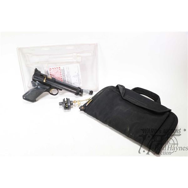 Crosman model 2244 .22 caliber CO2 powered pellet pistol, front sight partially broken and taped bac