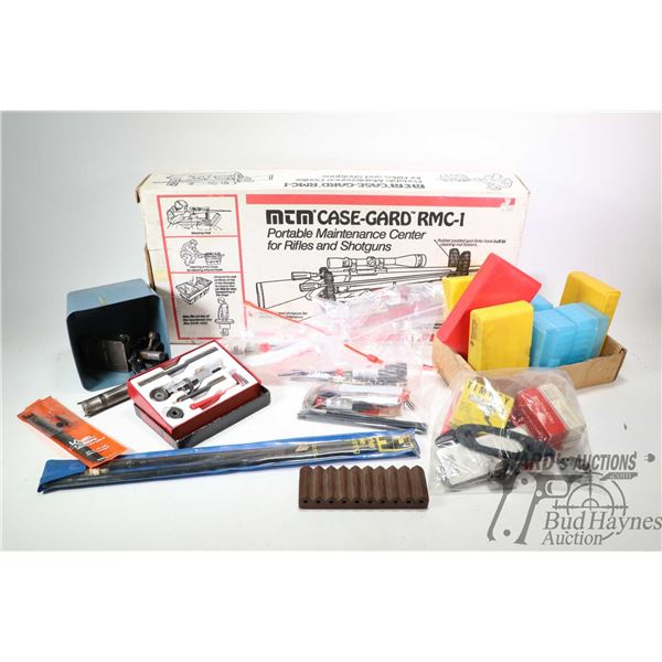 Selection of firearms accessories including boxed Case-Gard portable maintenance center, boxed Lee l
