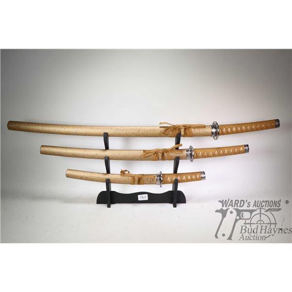 Set of three graduating sized decorator Katana swords with display rack