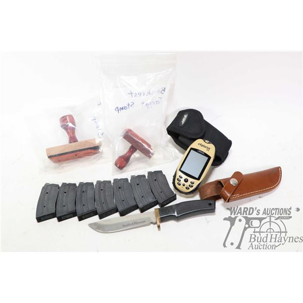 Smith & Wesson knife with leather sheath, two rubber stamps for making bench rest targets, Magellan