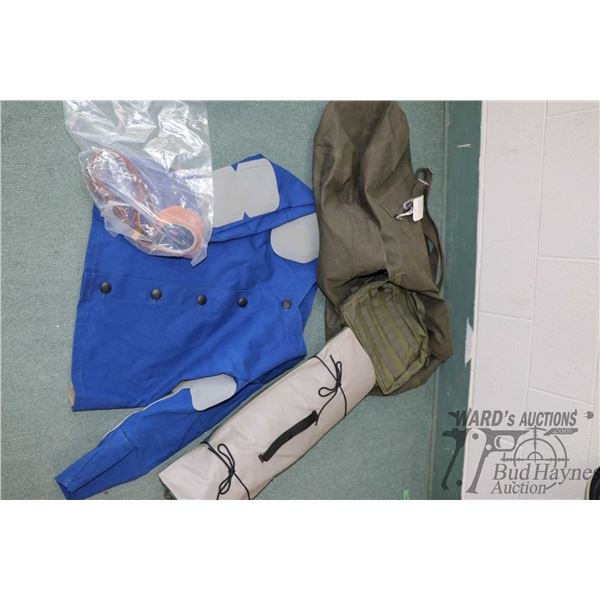 Duffle bag and shooting supplies including size 44 Champion Shooters Supply jacket, a shooting mat,