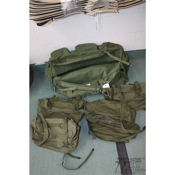 Duffle bag with assorted US Army satchels