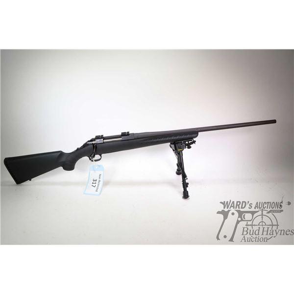 "Non-Restricted rifle Ruger model American, .223 Rem bolt action, w/ bbl length 22"" [Black parkerized"