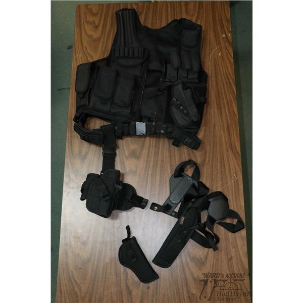 Black webbed vest with attached belt, webbed holster and ammo. pouches and a Uncle Mikes Sidekick sh