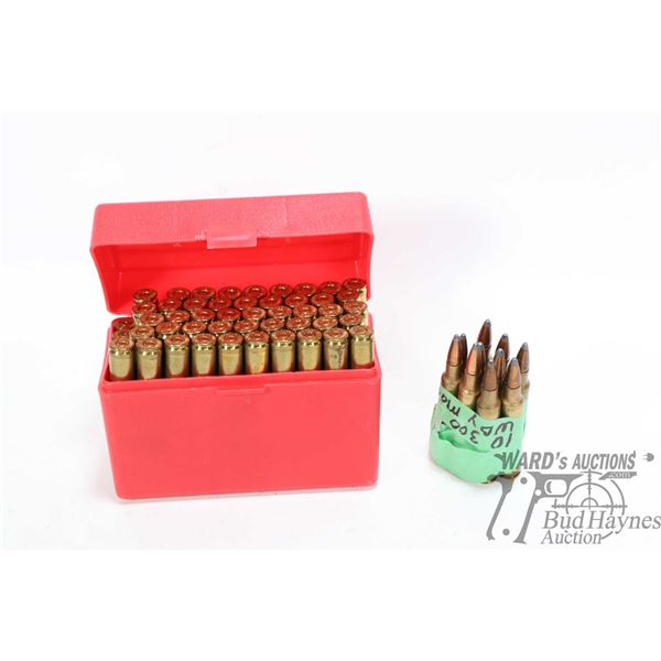 Plastic ammo case containing 46 rounds of .300 Magnum reloads plus 4 empty cases, 10 rounds of 300 W