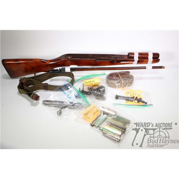 Selection of gun parts including Mosin- Nagant hand guard and bayonet, 18 count stripper clips, comp
