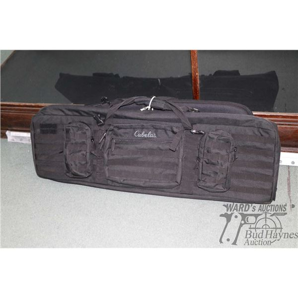 Two soft rifle cases including Cabala multi pouch with four sets of safety glasses and an Uncle Mike