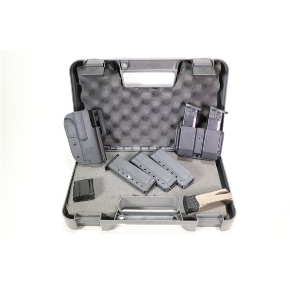 Selection of range gear including Smith & Wesson M&P holster, double mag pouch, two .40 cal ten roun