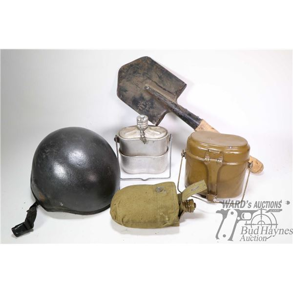 Selection of military supplies including insulated helmet, small shovel, water canteen in canvas pou