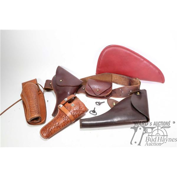 Selection of leather holster including flap holster with pouch and belt, tooled leather etc.