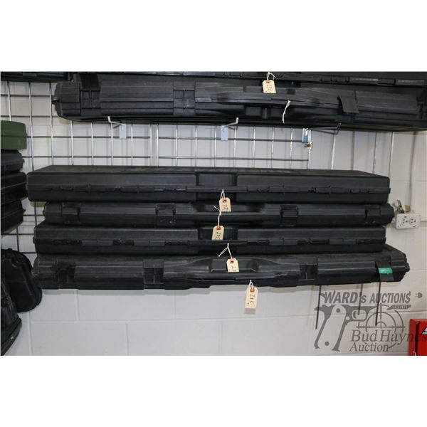 Four assorted hard plastic rifle cases