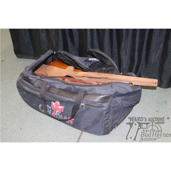 Duffle bag with a large selection of rifle stocks of unknown fitment
