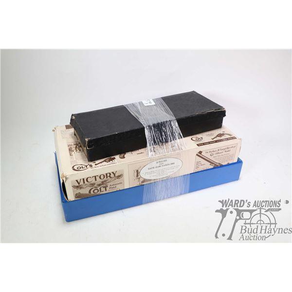 Three vintage original Colt cardboard boxes including Colt's Single Action Army Revolver, Anaconda a