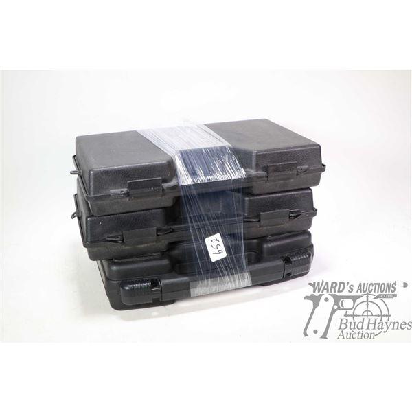 Three foam lined hand gun cases