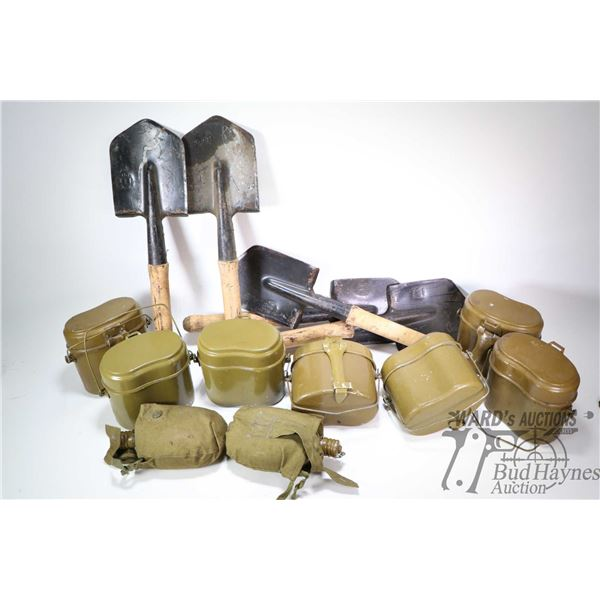 Seven military metal lunch kits, two canteens in canvas pouches and five small spades