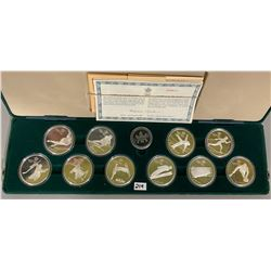 LOT OF 10 SILVER $20 COINS IN OLYMPIC COMMEMORATIVE SET - 1988