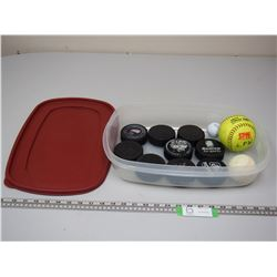 HOCKEY PUCKS & BALL IN PLASTIC RUBBERMAID CONTAINER