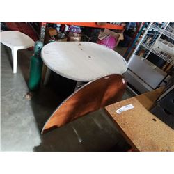 White plastic patio table and half moon wood table