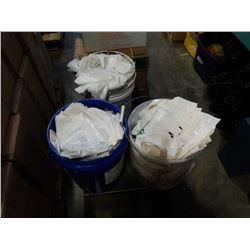 Three buckets of plastic bags