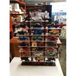 GOLDEN AGE OF FORD 25 CAR DIE CAST CAR SET ON STAND