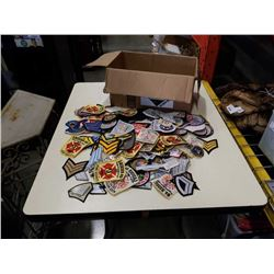 Box of various iron on patches