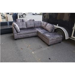 BRAND NEW GREY FABRIC SECTIONAL W/ STORAGE OTTOMAN - RETAIL $949, 1 CUSHION COSMETIC DEFECT, ANGLED