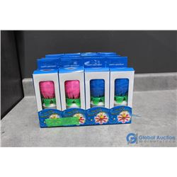(4) Packs of 4 Musical Flower Candles