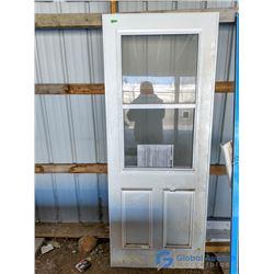 """Unused Aluminum Storm Door - 31.25"""" x 78.5"""""""