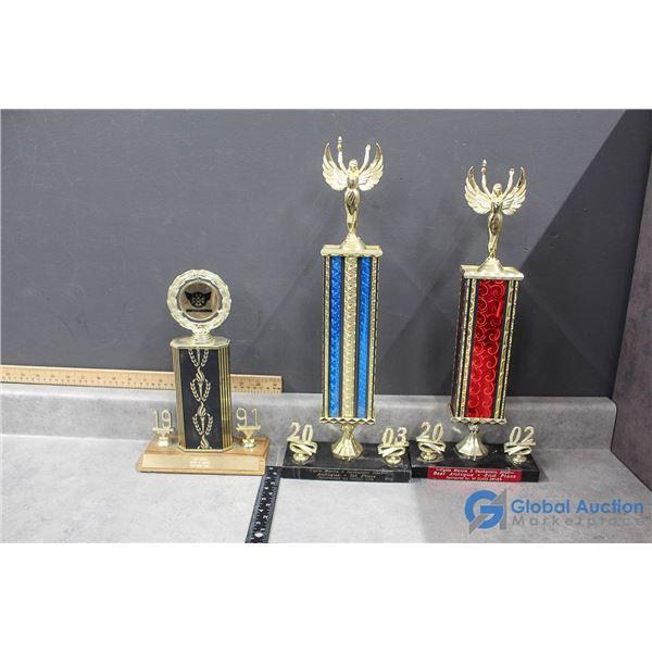 (3) Trophies