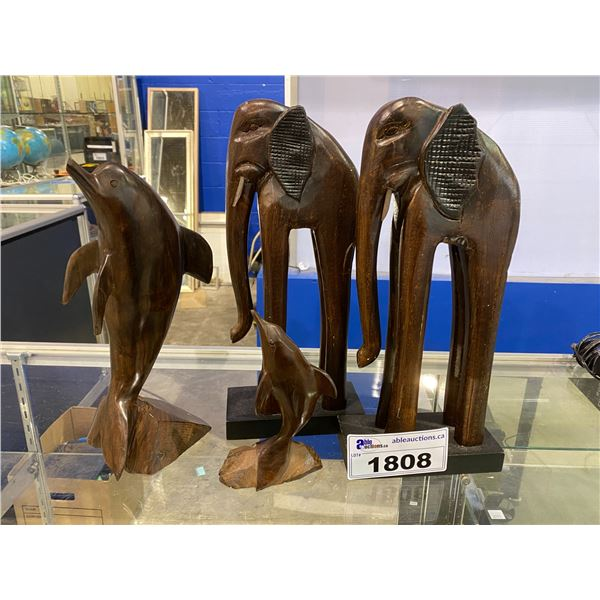 4 WOODEN CARVED ANIMALS (2 ELEPHANTS/ 2 DOLPHINS) DOLPHINS ARE IRON WOOD