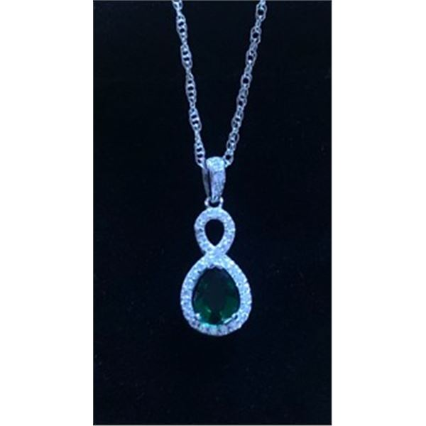 Emerald green stone set in rhinestones and sterling silver from Wilderness Mint