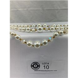 1950's Triple strand faux pearl necklace