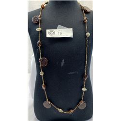 Necklace with glass beads of amber colour