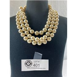 A Large & Impressive 3 Strand 70's Faux Pearl Necklace