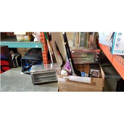 Box of store return appliences and vacuum
